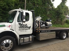 Sulver Motorcycle on Flat Bed
