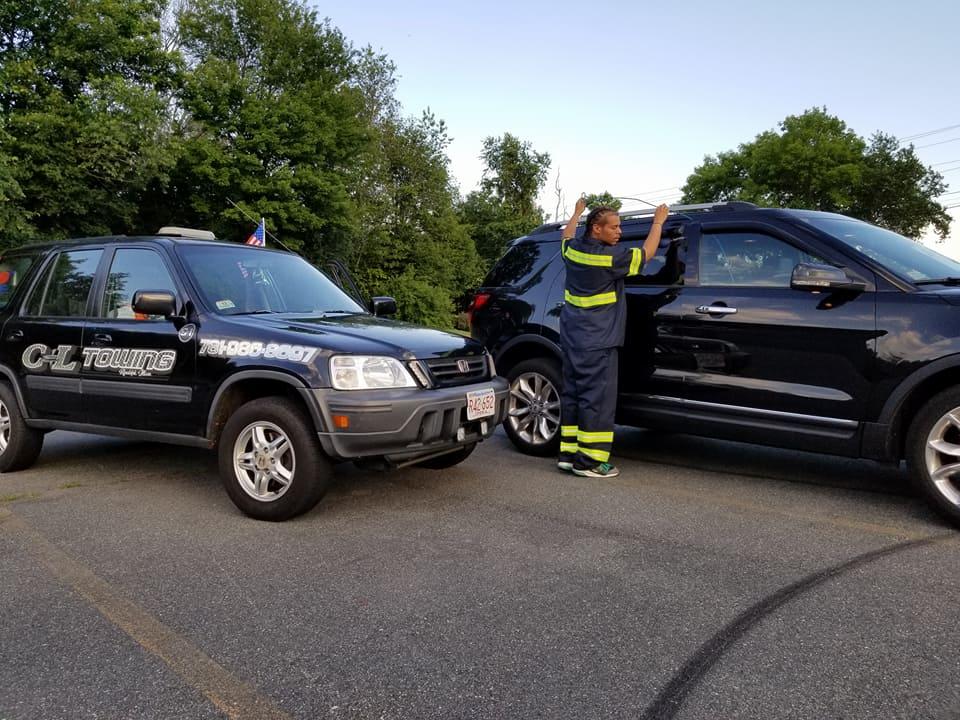 Technician Unlocking a Car Door