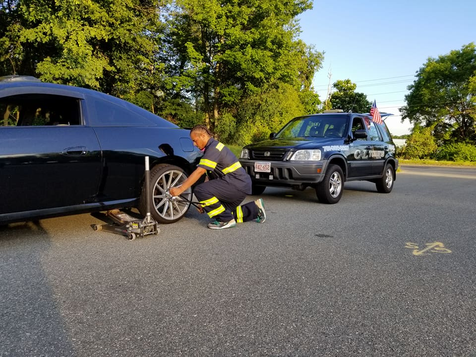 Technician Changing a Tire